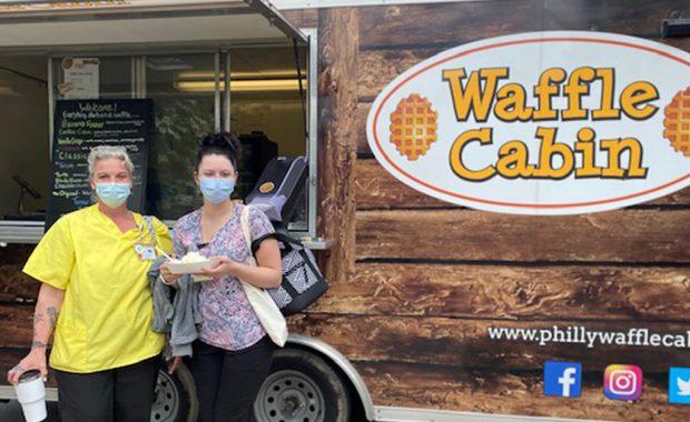 Nurses Week Waffle Truck with two nurses in masks enjoying waffles and ice cream